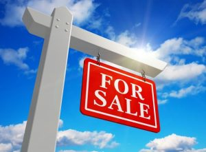 a For Sale real estate sign